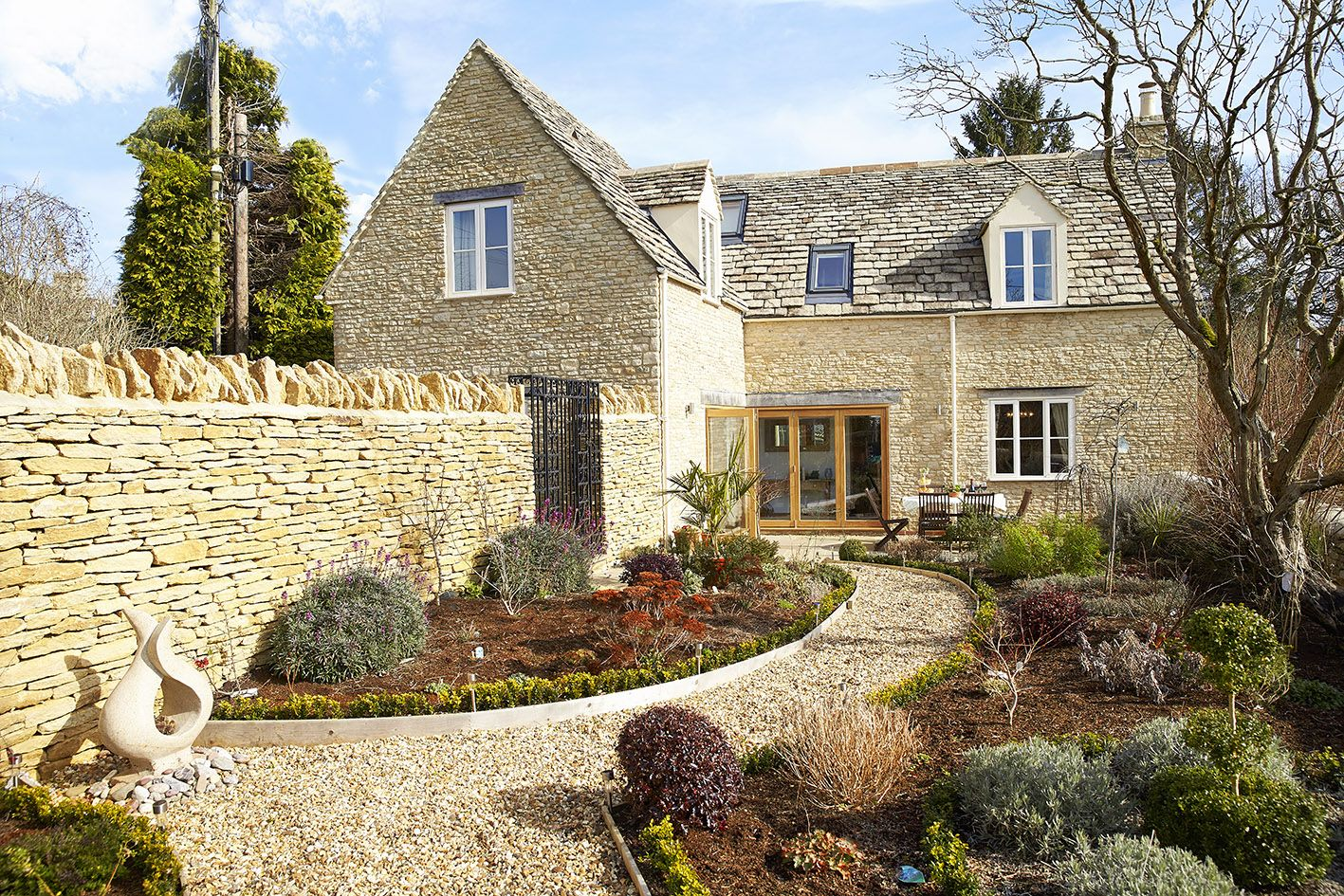 Little Maunditts Cottage enclosed courtyard garden with box lined gravel paths and flower beds