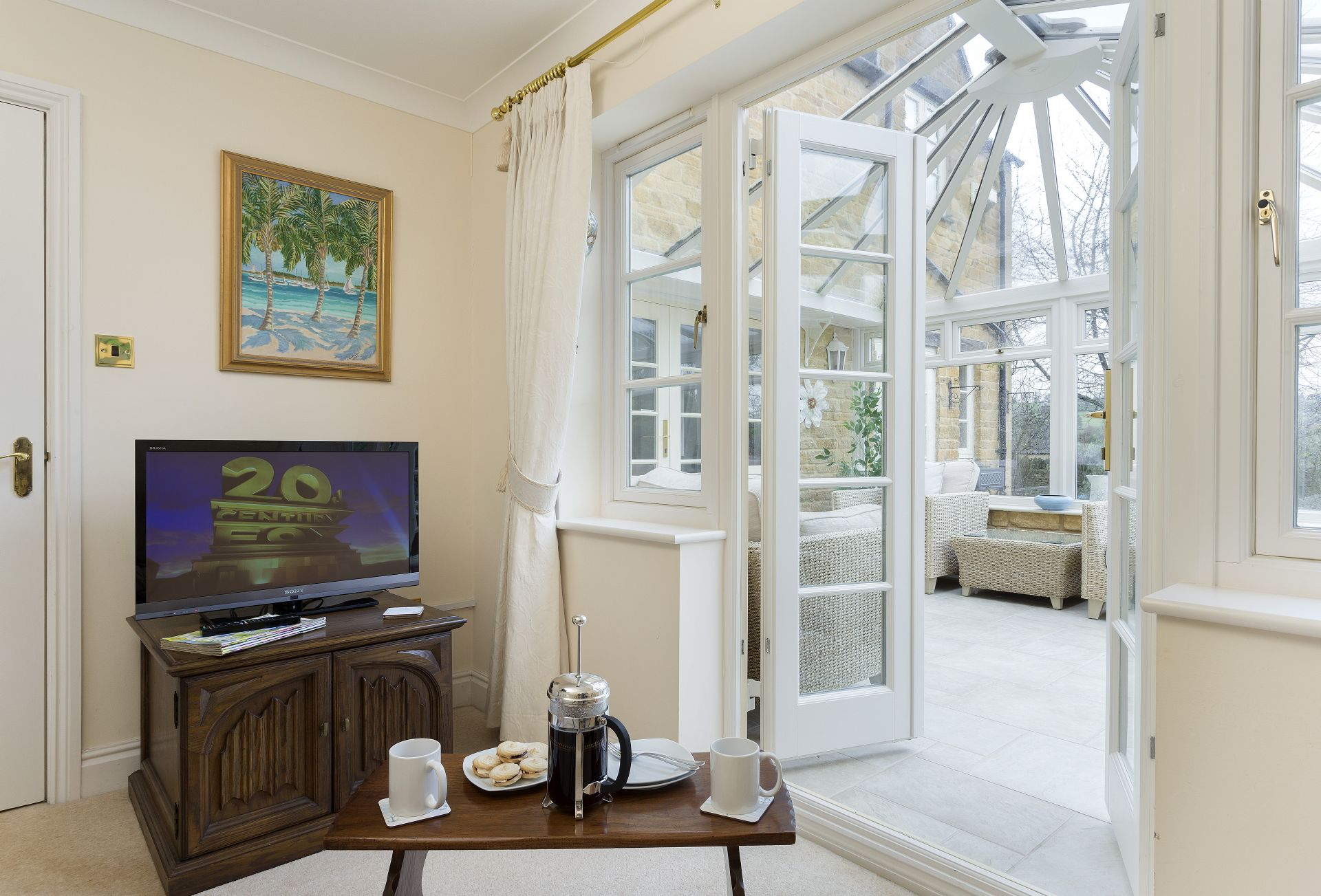 Ground floor: View leading from the dining room into the conservatory