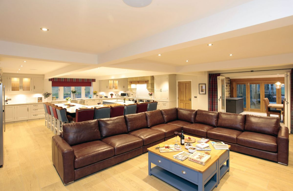 Ground floor: Open plan family kitchen with stunning Yorkshire range in front of the sofa area i