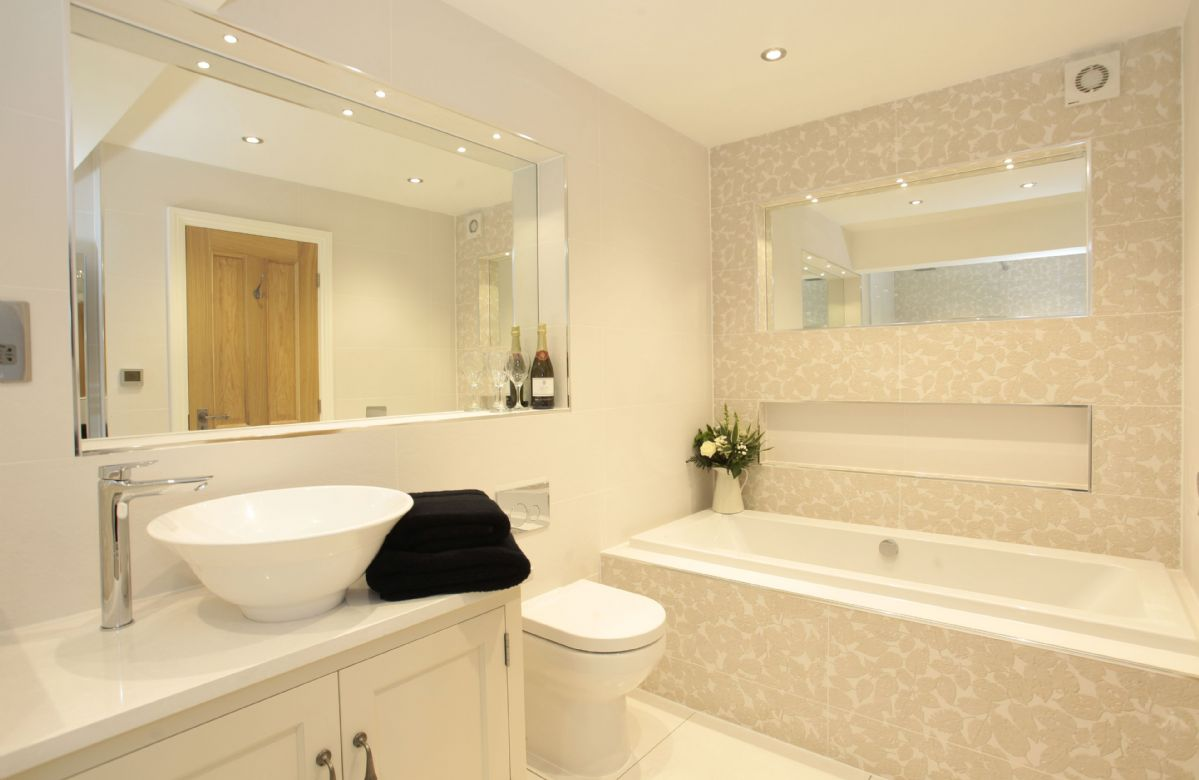 First floor: Ensuite with walk in shower and separate bath