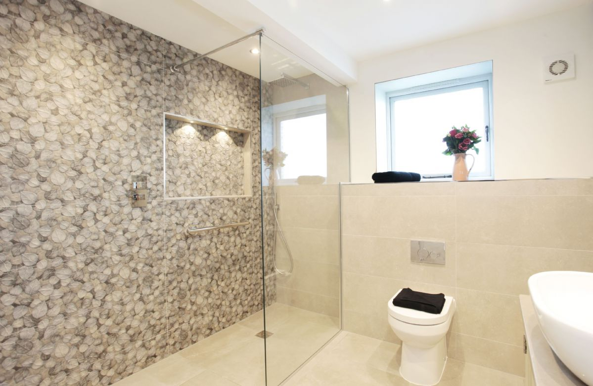 First floor: En suite with large walk in shower