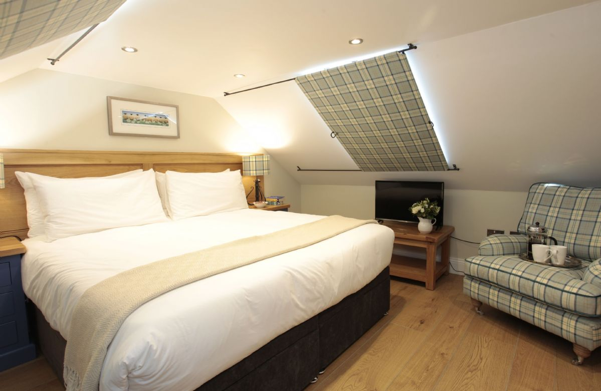 Third floor: Double bedroom with 6' zip and link bed with ensuite and views
