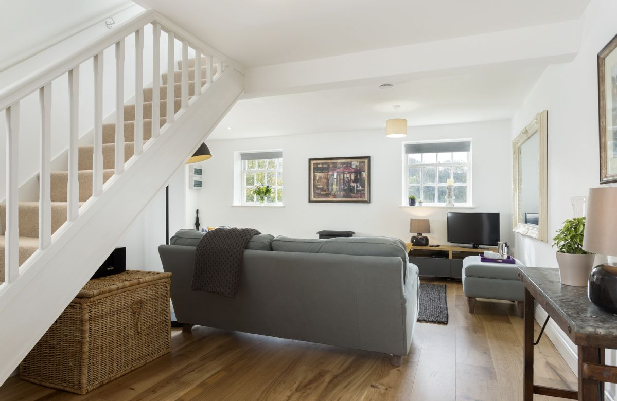 Ground floor: Open plan living area with stairs to the first floor