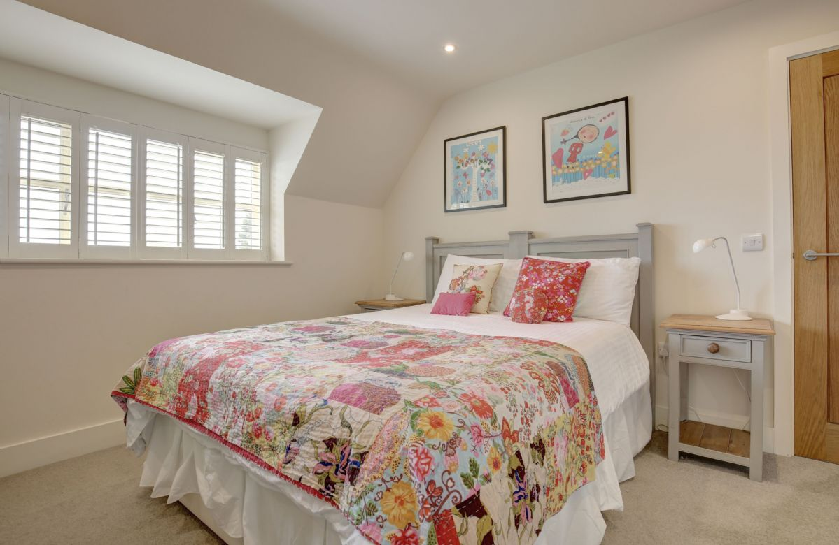 First floor: Bedroom two (The Floral room) with a 5' zip and link king size bed