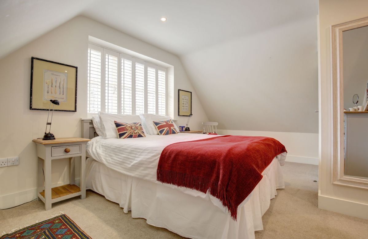 First floor: Bedroom one (The Britain room) with a 5' zip and link king size bed and en-suite shower room