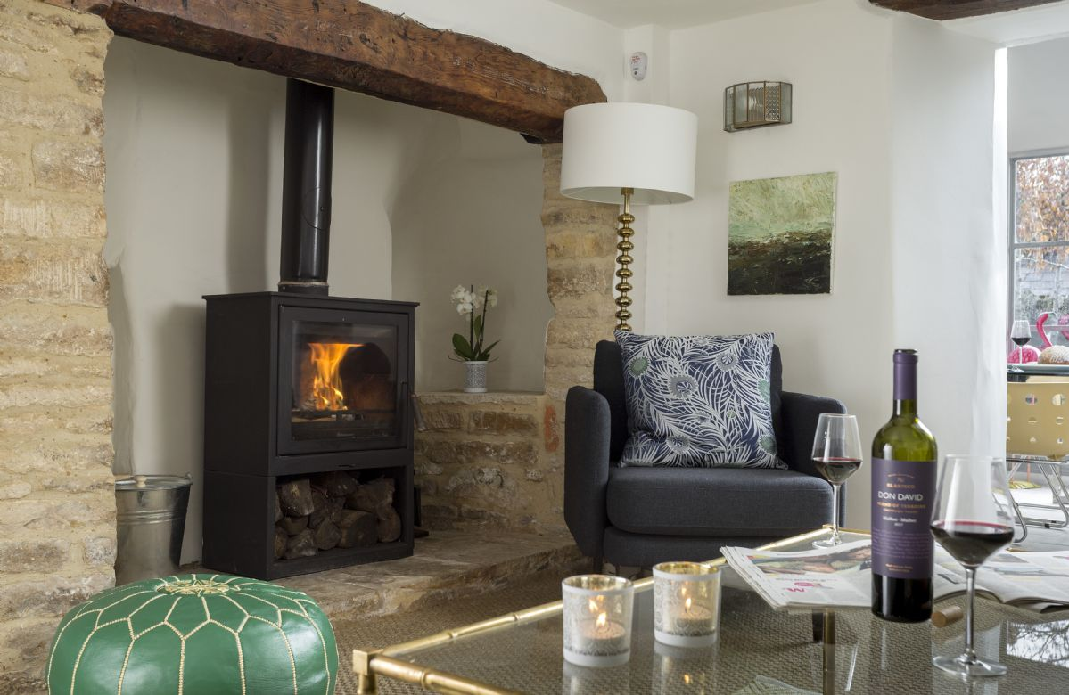 Relax with a glass of wine by the wood burning stove