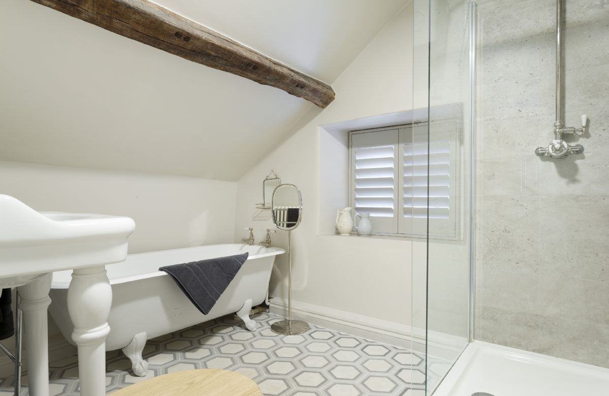 First floor:  En-suite bathroom with bath and separate shower