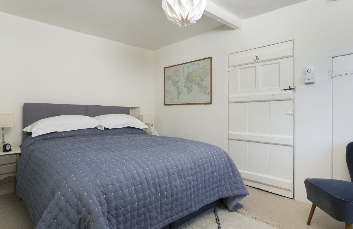First floor: Bedroom with 6' super king size bed (can be configured as two 3 singles on request)