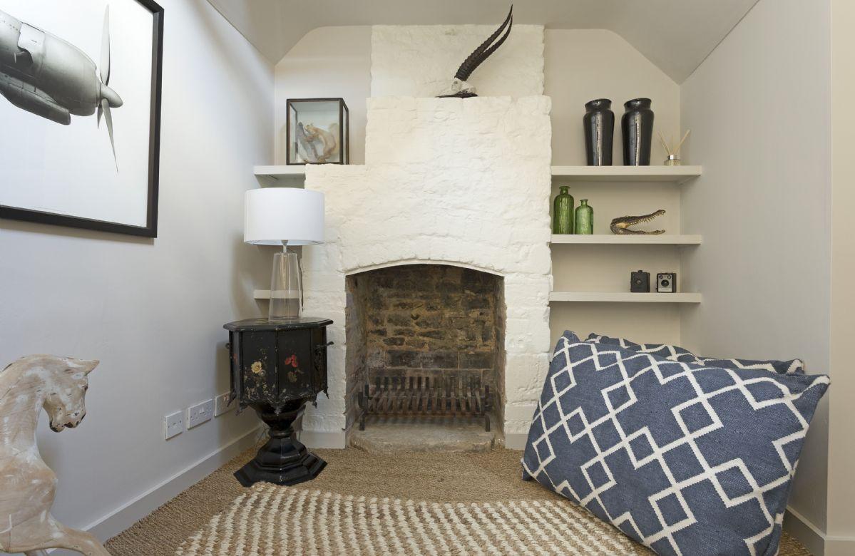Ground floor:  Snug with comfy floor cushions and sofa.