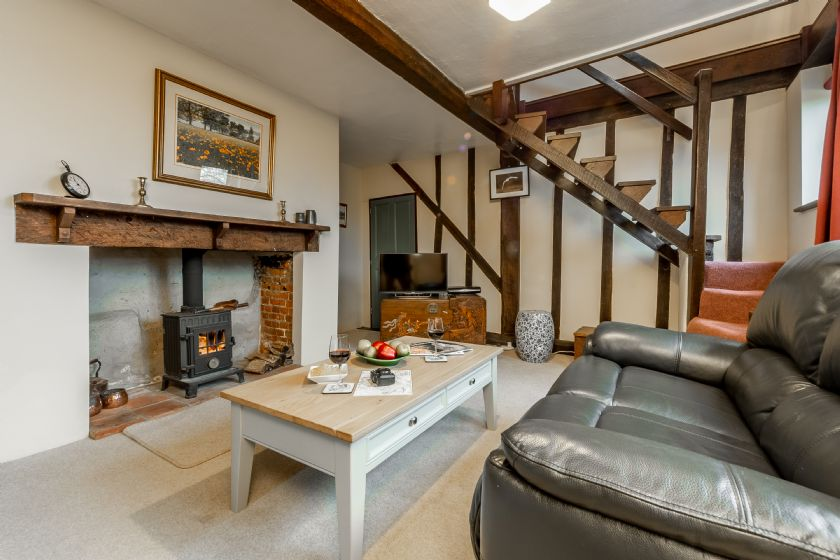 Ground floor: Seating area with wood burning stove