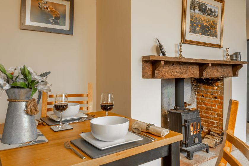 Ground floor: Dining table seating two with wood burning stove