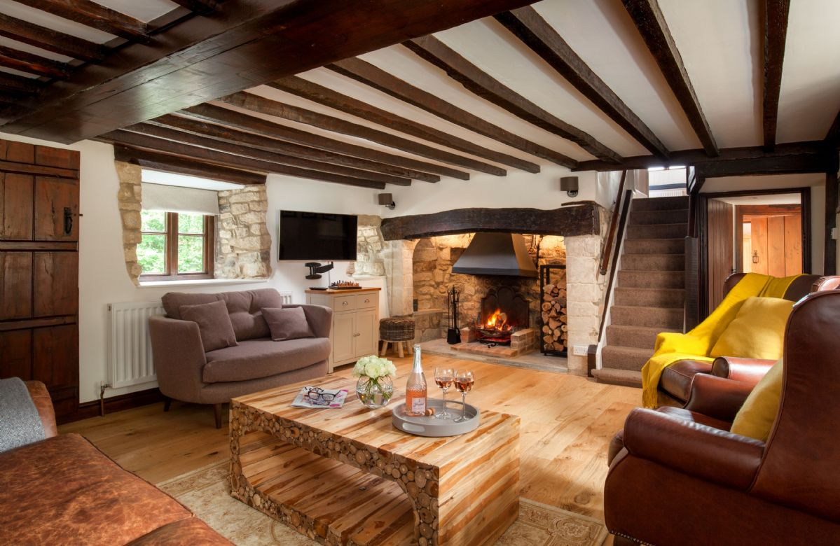 Ground floor: The stunning and inviting sitting room with inglenook fireplace and open fire