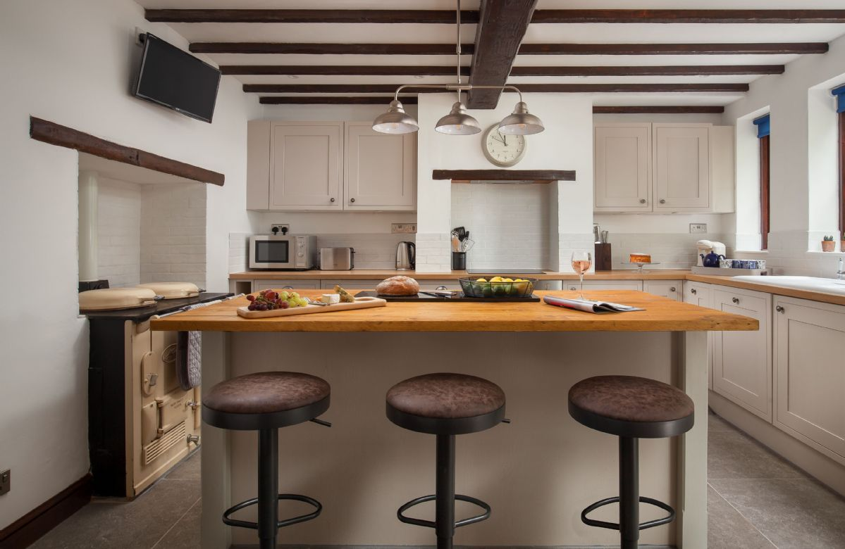 Ground floor: Island in the kitchen with three barstools
