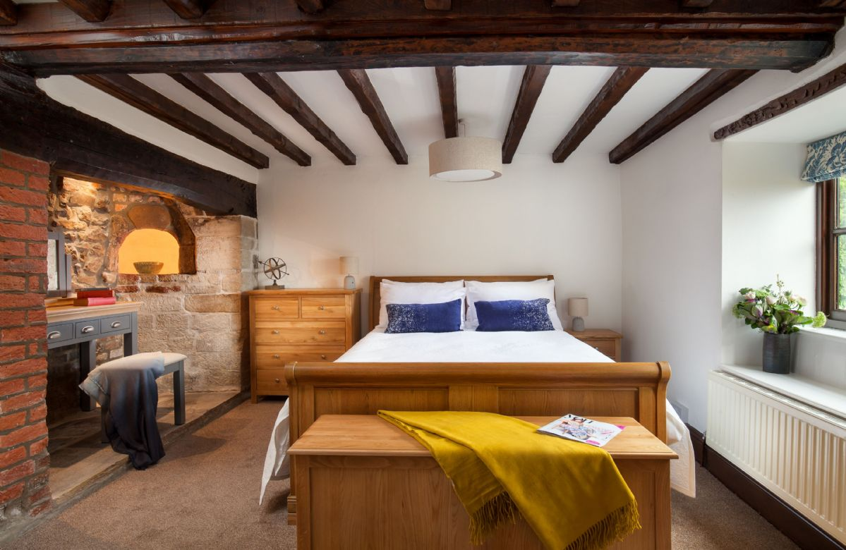 Ground floor: Double bedroom with original beams and dressing table