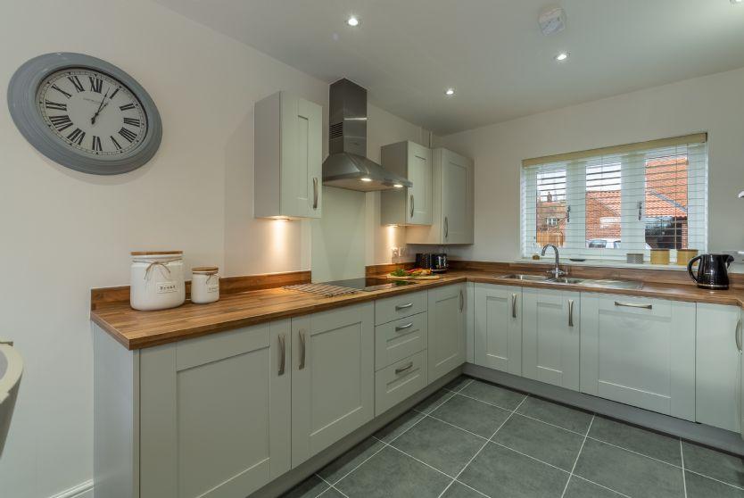 Ground Floor: The modern kitchen has painted unts with wooden worktops