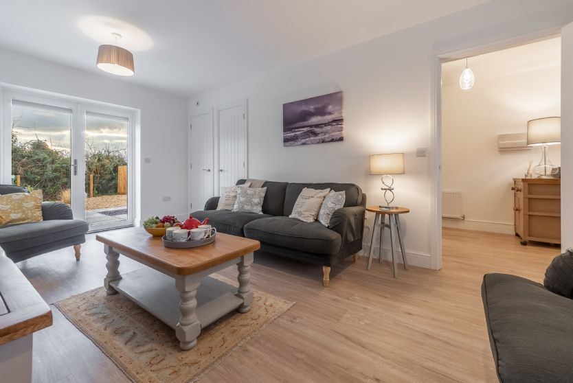 Ground Floor: Sitting room is light and airy with plenty of seating