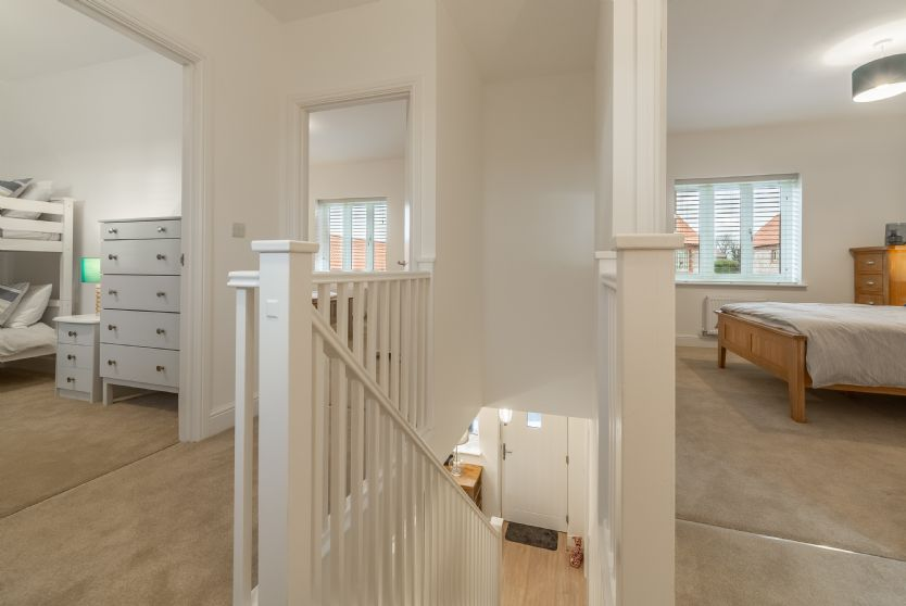 First floor: Landing with doors leading to bedrooms and family bathroom