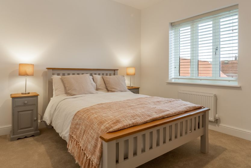 First floor: Bedroom two with double bed and views to the front