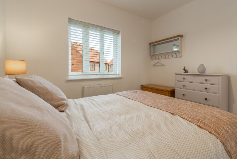 First floor: Bedroom two has plenty of storage and a peg rail with mirror