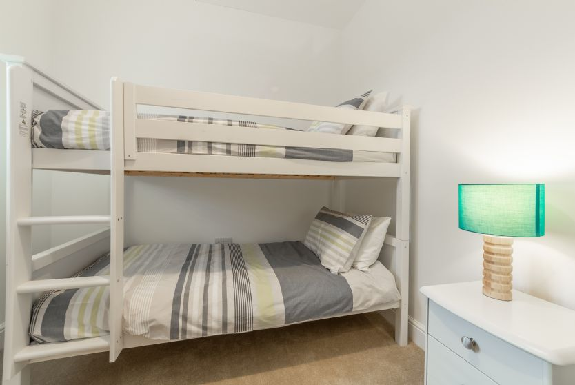First Floor: Bedroom 3 comes with full-size bunk beds