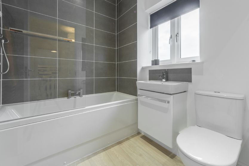 First Floor: Family bathroom with bath with shower above