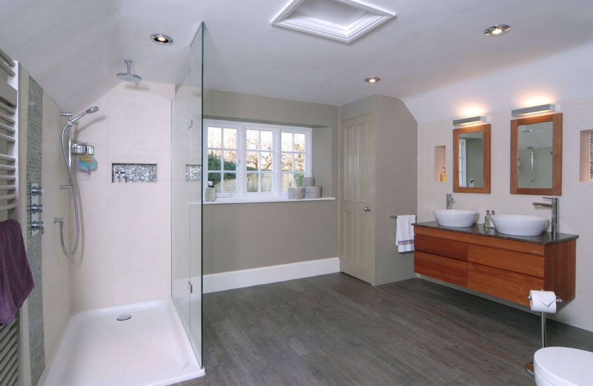 First floor: En-suite shower room with double basin and heated towel rack