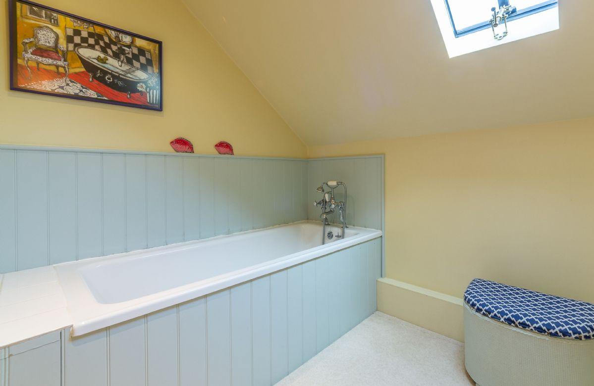 First floor: Family bathroom with bath and heated towel rail
