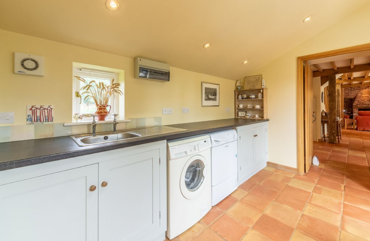 Ground floor: Large utility room with washing machine and tumble dryer