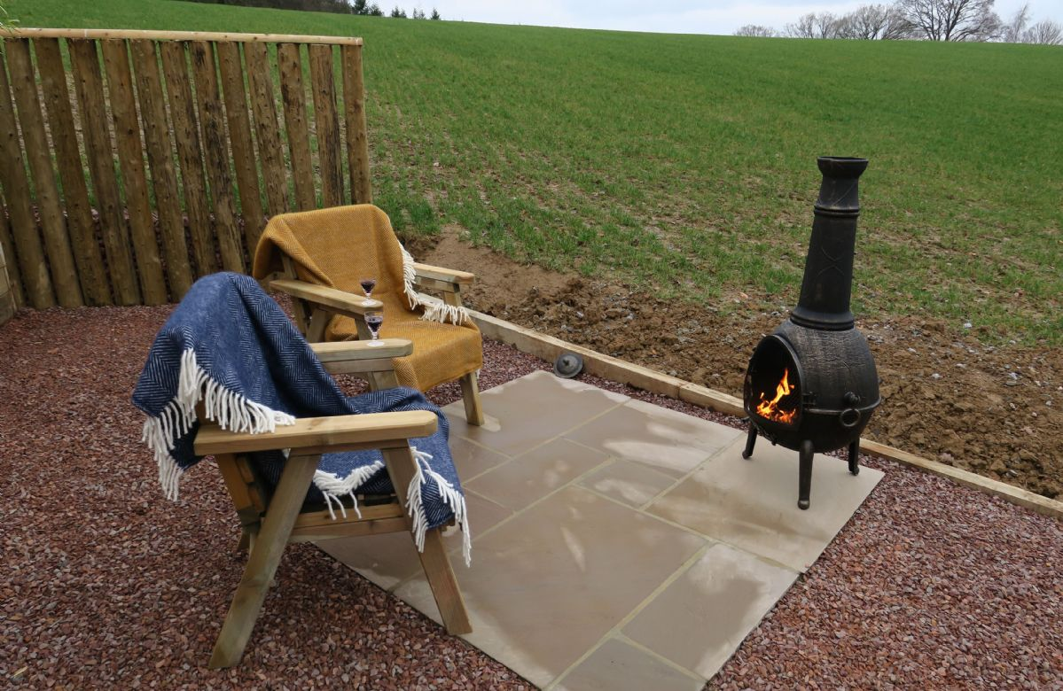 Relax by a warming fire of the chimenea whilst taking in the views