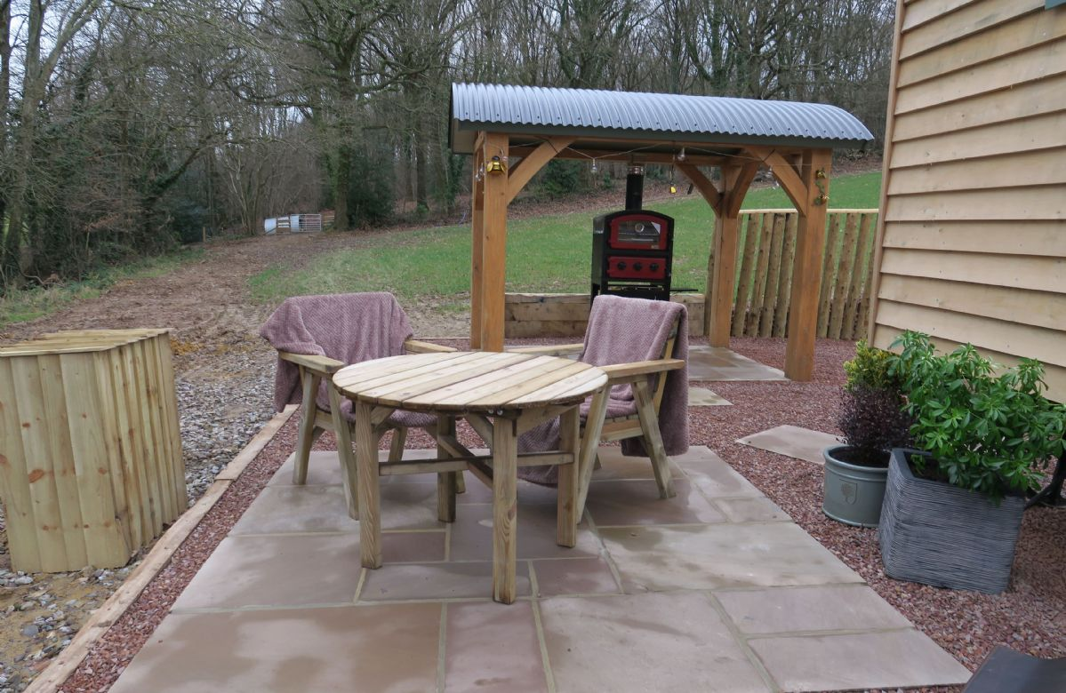 Outdoor dining area next to the outdoor oven and firepit