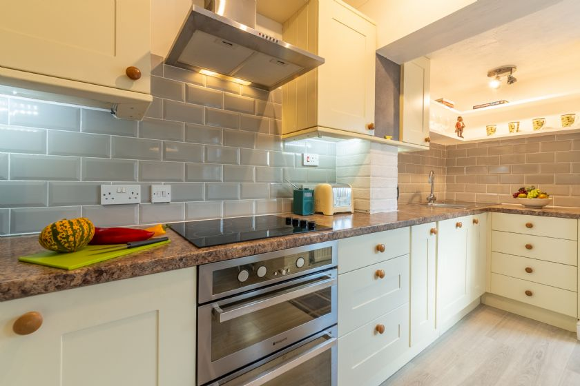 Ground floor: Kitchen area with electric cooker, fridge/freezer, microwave and dishwasher