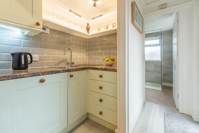 Ground floor: The shower room is accessed through the kitchen at the back of the cottage.