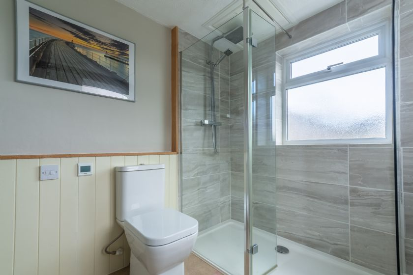 Ground floor:  Shower room with a wash basin and WC