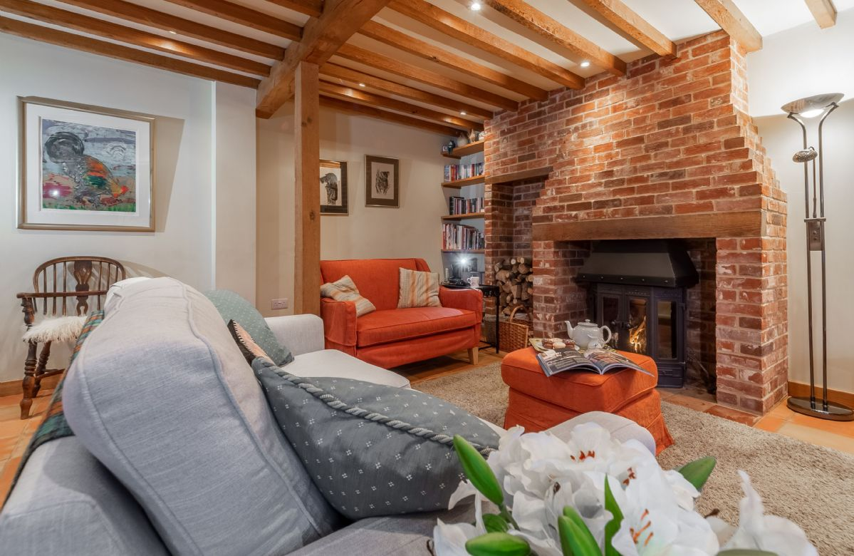 Ground floor: Comfortable beamed sitting room with traditional inglenook fireplace