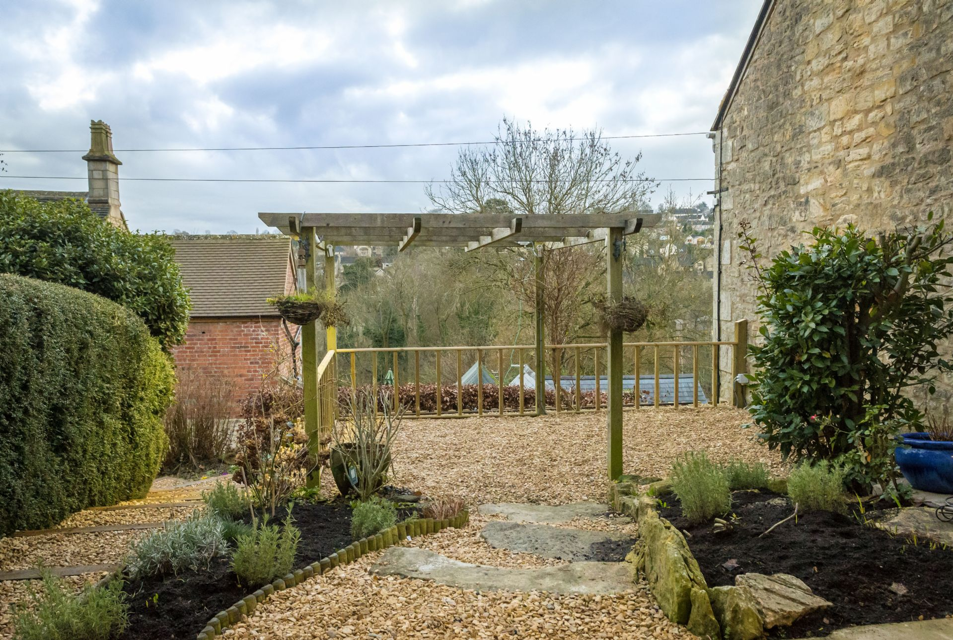 Outside: fully enclosed garden to the front of the cottage