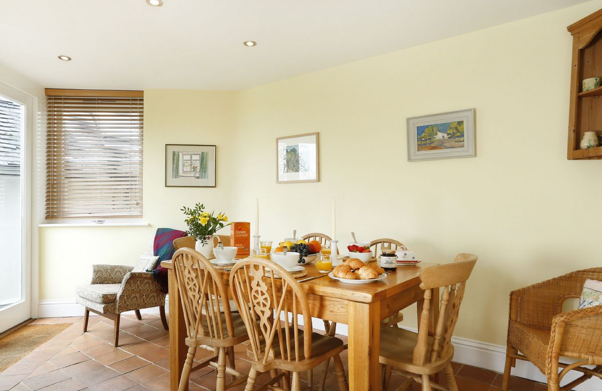 Ground floor: Dining table comfortably seats up to six guests