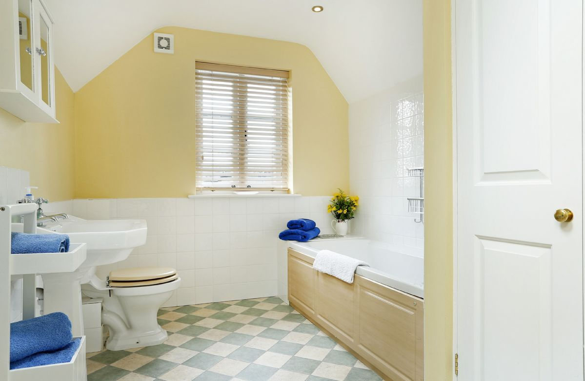 First floor: Family bathroom with bath and shower attachment, wc and wash basin