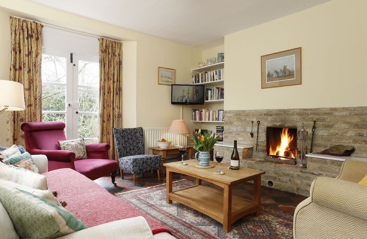 Ground floor: The comfortable sitting room with open fire place