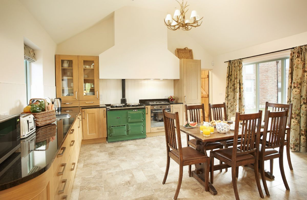 Ground floor: Kitchen with large breakfast table and granite topped counters
