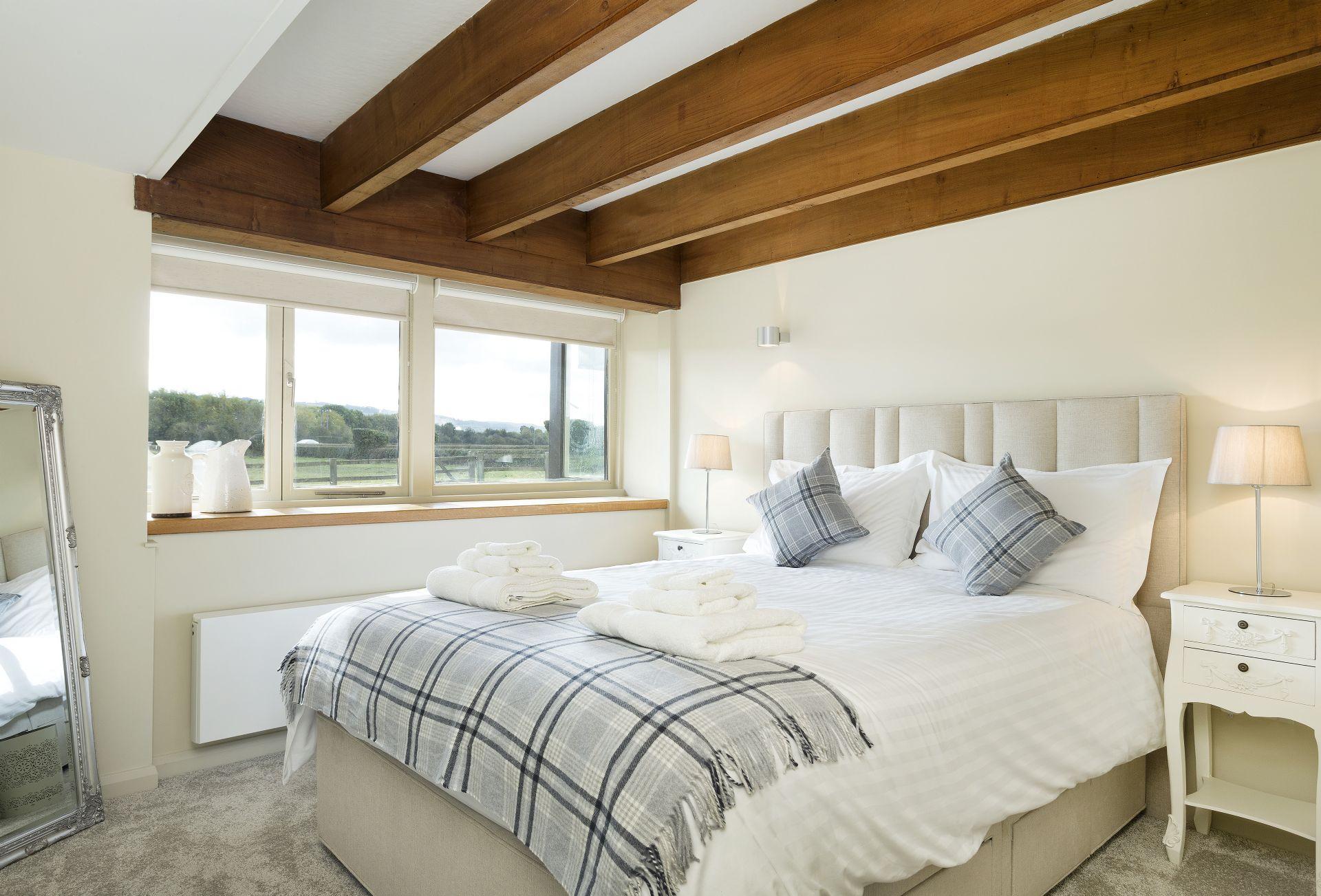 Ground floor: Double bedroom with king-size bed and shower wet room next door