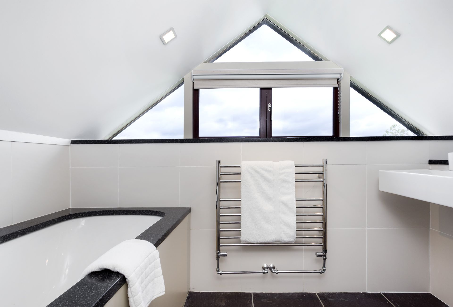 First floor: Unique design in the bathroom with unusual windows in the rooftop