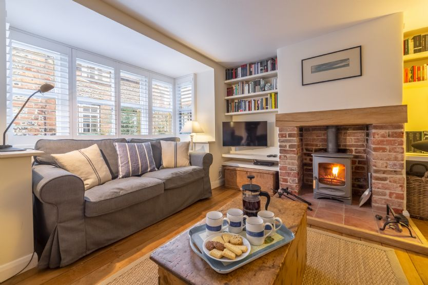 Ground Floor: Sitting room with log burning stove