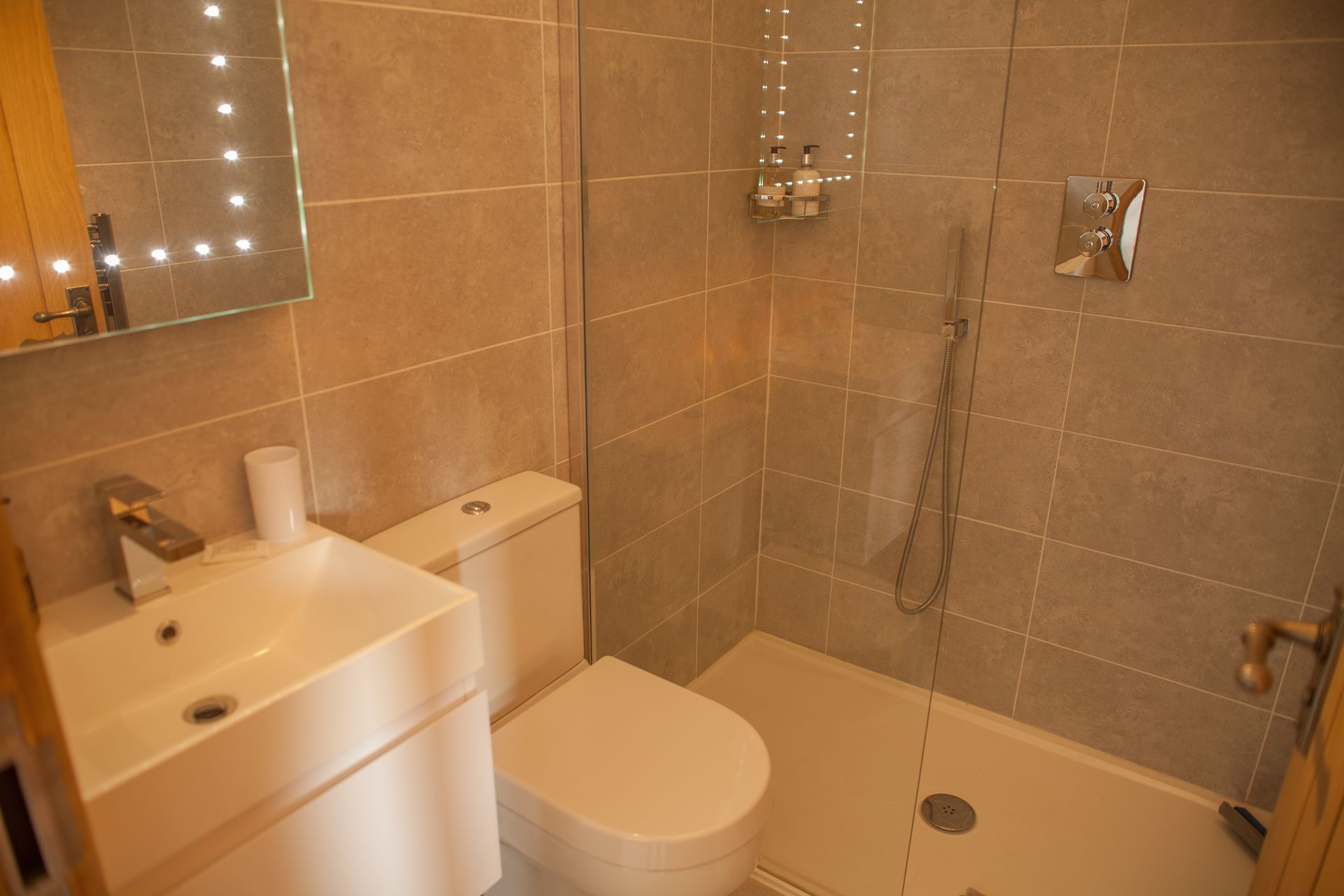 First floor: En-suite with bath and separate shower