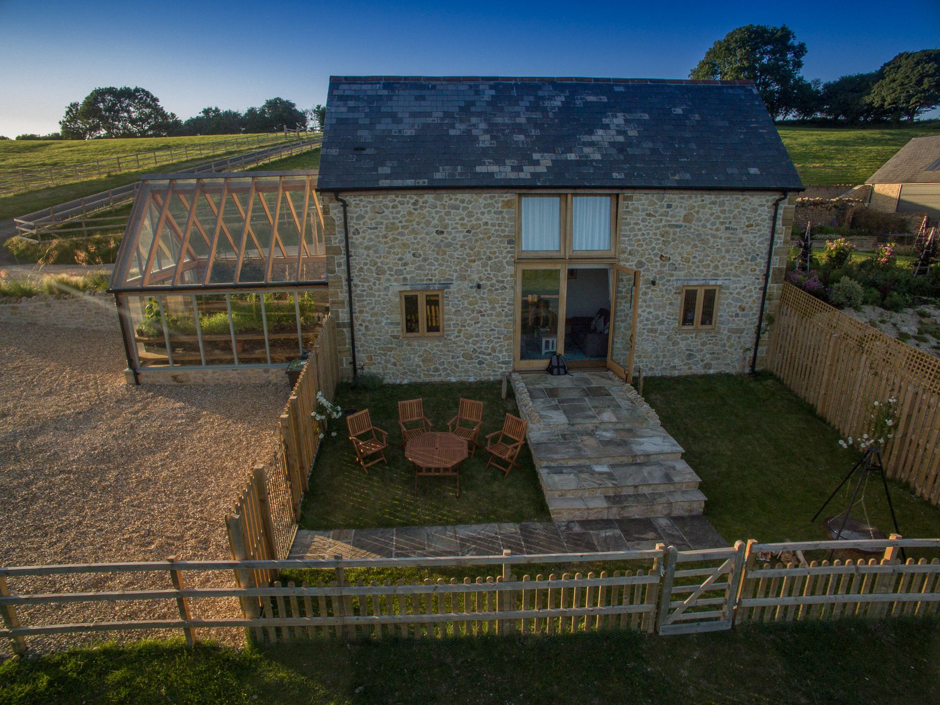 Small enclosed south facing garden with a gate leading out onto the open countryside