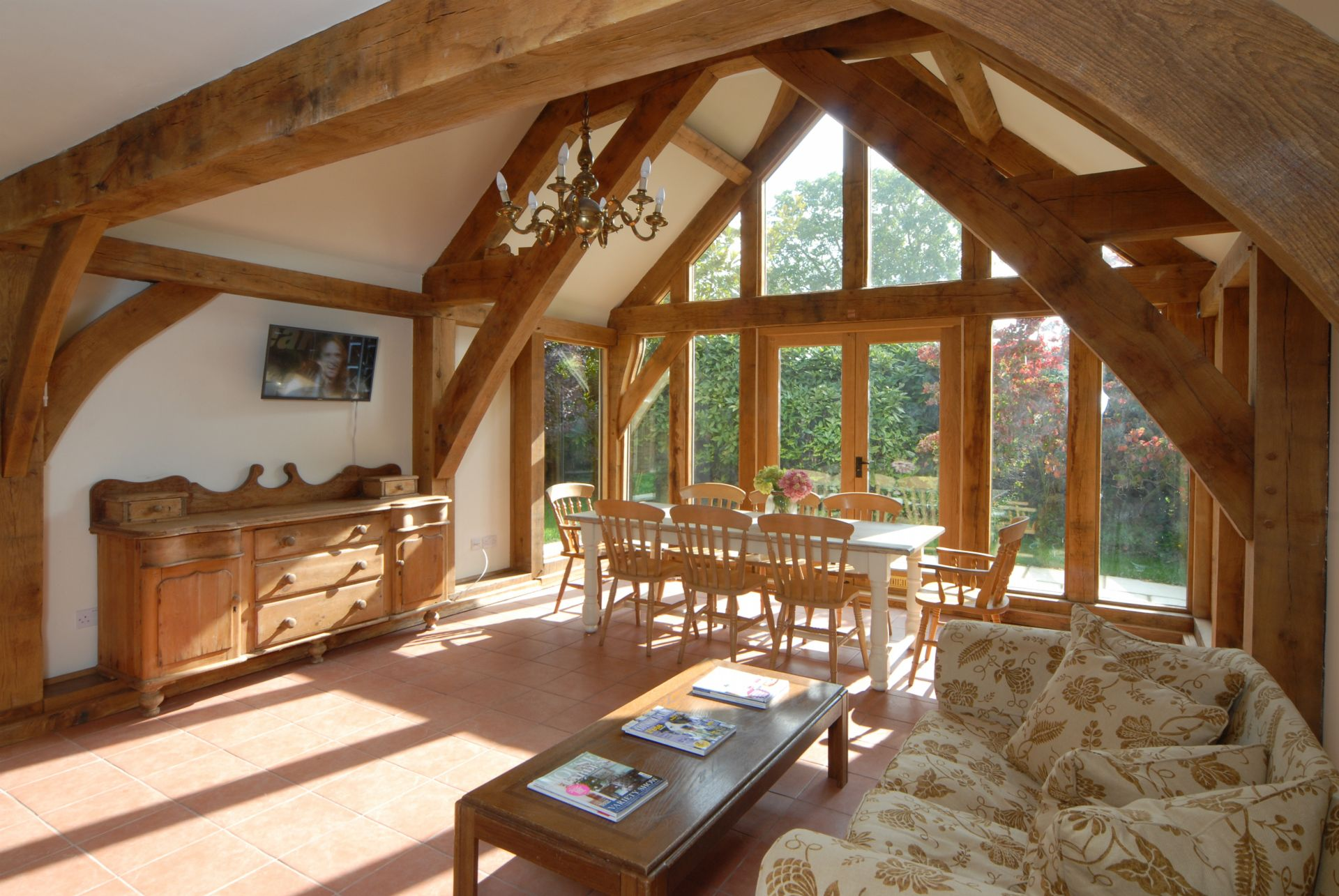 Hiron's Piece ground floor: impressive beams with full height windows in the dining area
