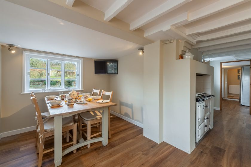 Ground floor: Breakfast area in kitchen with seating for four