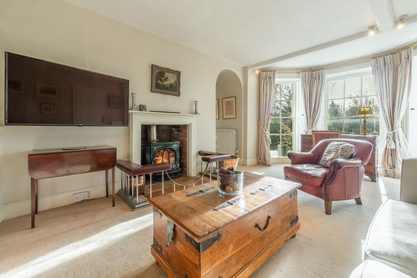 Ground floor: Family room with bow fronted window and views to the front of the house