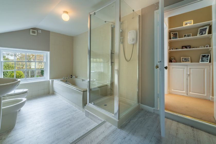 First floor:  En-suite bathroom with separate shower, bath, wash hand basin, bidet and toilet