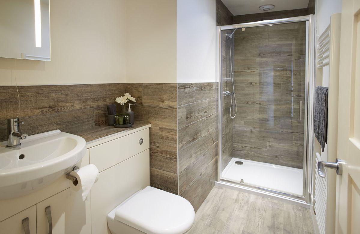 Ground floor: En suite shower room to the master bedroom