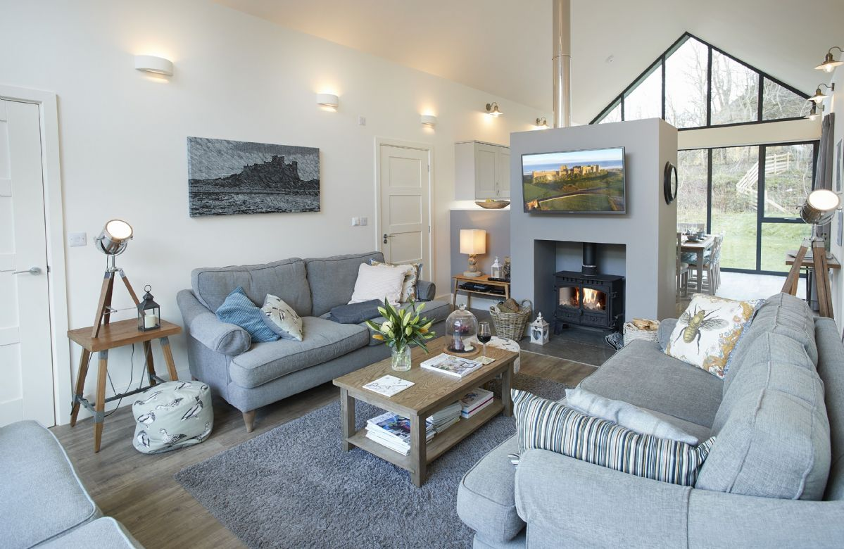 Ground floor: The wood burning stove is a wonderful central feature in the sitting room